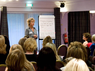 Dr Susie Mitchell pictured delivering a training course/workshop on Sales and leadership available throughout the UK